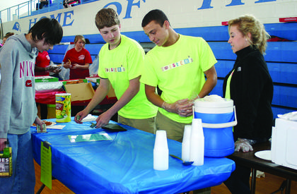 """Conner McCourt, Marquis Franklin and Ashley Hornback sold """"Twisters"""" pretzels at the mini mall."""