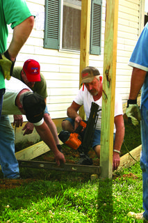 "Volunteers from Oak Hill Baptist Church built a ramp Saturday at the home of Fay Graham outside Hodgenville. Wayne ""Popeye"" Graham is holding the level; Jeff Hisle is at right; Scott Ward is at left. Others who worked are Pat Eastridge, Randy Peace, Gordon Bright, Scott Ward, Junior Fulkerson, Larry Fulkerson, Kenny Fulkerson, Bro. Eric Page, Ethan Crain and Bobbie Walsh. Cookie Graham, Vickie Graham and Crystal Viers served breakfast to the crew."