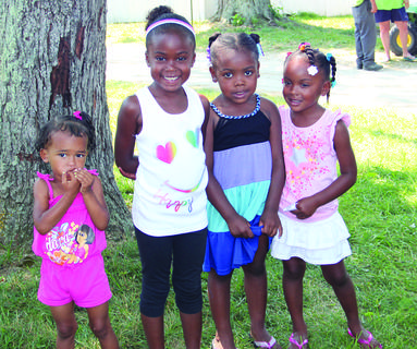 These girls waited patiently for lunch to be served on Kids Day at the LaRue County Fair. From left to right, Kara Williams-Lee, Adaysha Lee-Bufford, Sabriyya Lee and Anya Lee-Bufford.