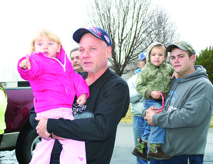 Izabella Browne, 2, and Matthew Meredith, 3, watched for the arrival of Santa Claus outside Magnolia Fire Department on Christmas Eve.