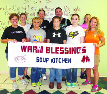 As part of the United Way Day of Service, employees and family members from Dow Corning volunteered at Warm Blessings Soup Kitchen. The group worked several hours scrubbing the stove and ovens, cleaning ventilation ceiling vents, washing shelves, sorting and checking dates on food, mopping, scrubbing tables, cleaning windows, mowing grass and cleaning up outside the building. From left, Pam Bowling, Jennifer Mabry, Susan Carter, Donna, Victor, Greg and Maddie Helm, and Whitney and Laura Hay.