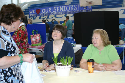 Lora Lamb, left, vice president of Hodgenville Woman's Club, and Opal Dail, spoke with visitors at their booth at Saturday's Expo.