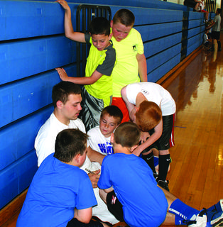Kody Key-Close is surrounded by Future Hawk campers Curtis Ford, Elam Stillwell, Jagger McBride, Luke Howell, Jacob Hunter and Mason Thompson as he works on his team's lineup.