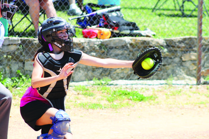 catcher Kristen Boone holds on to the ball for the third strike.